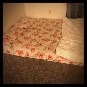 Queen mattress with sheet set and comforter set.